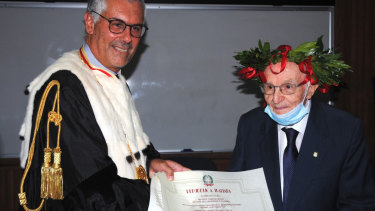Giuseppe Paterno, 96, right, graduated at the top of his class from University of Palermo with a degree in history and philosophy, becoming the oldest person in Italy to do so.