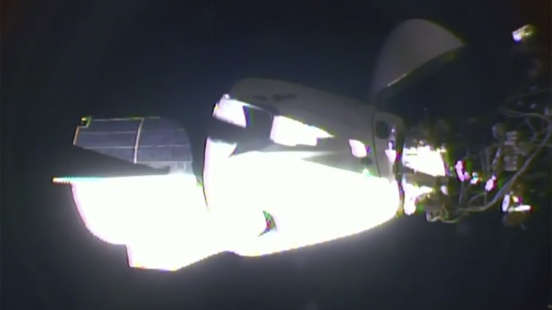 US astronauts on SpaceX Dragon capsule dock on ISS