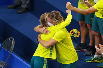Ariarne Titmus embraces Coach Dean Boxall after the medal ceremony for the women's 400m freestyle final on Monday.