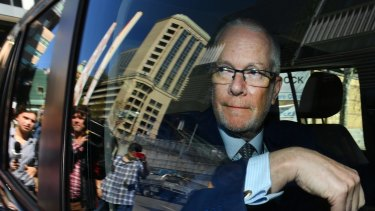 Former ABC chairman Justin Milne leaves the ABC studios in Sydney after resigning his chairmanship on September 27.