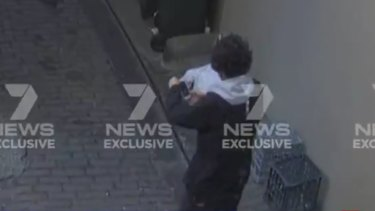 Mert Ney is captured via CCTV in the laneway near Clarence Street.