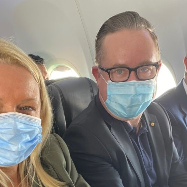 Happy with the middle seat in an early flight back in June: Qantas chief executive Alan Joyce, centre, with chief customer officer Steph Tully and Qantas International chief executive Tino La Spina.