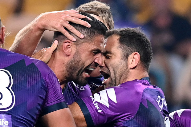 Cameron Smith celebrates Jesse Bromwich's first try against Canberra on Friday night.