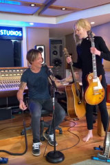 Country music star Keith Urban in his home studio with his wife, actress and 'roadie' Nicole Kidman.