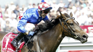 Jockey Glen Boss and Makybe Diva creating history by winning their third successive Melbourne Cup.