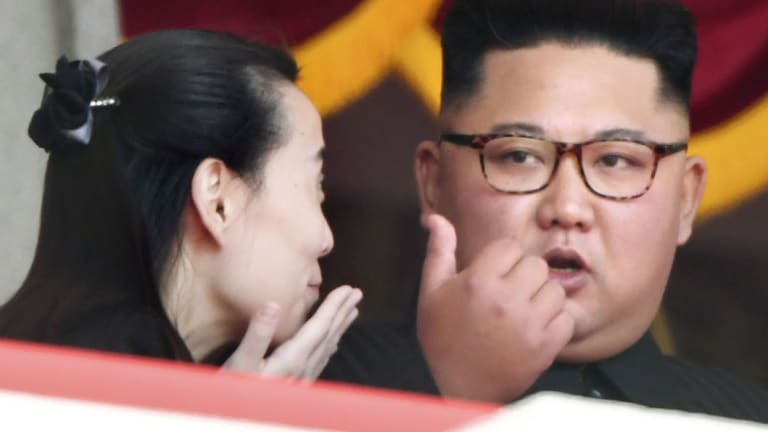 North Korean leader Kim Jong Un  talks with his sister Kim Yo Jong, during a parade for the 70th anniversary of North Korea's founding day.
