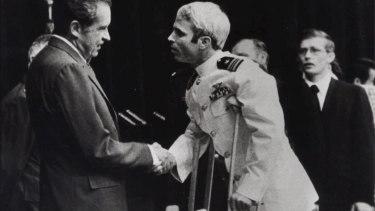 In this May 25, 1973, file photo, US Navy Lieutenant Commander John McCain is greeted by President Richard Nixon, left, in Washington, after McCain's release from a prisoner of war camp in North Vietnam.