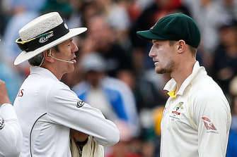 Caught: Umpires Richard Illingworth (left) and Nigel Llong confront Cameron Bancroft in Cape Town, scene of the sandpapergate crime.