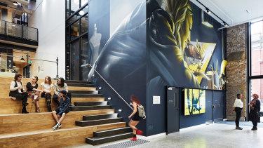 The atrium features a graffiti wall by local artist Smug.