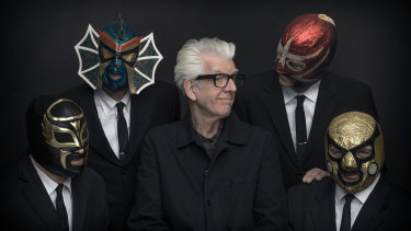 Nick Lowe with Los Straitjackets.