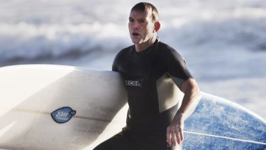 Tony Abbott, surfing in 2014.