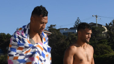 Touching base: Karmichael Hunt (right) has been checking in with Israel Folau.