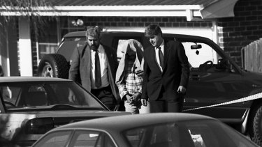 Police taking away Ivan Milat from his Eaglevale home after an early morning raid in 1994.