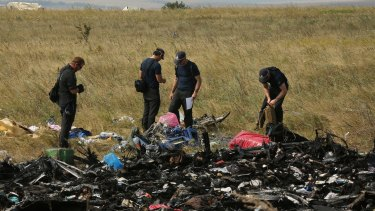 Australian Federal Police officers and their Dutch counterparts search for human remains and personal belongings from the MH17 crash site.