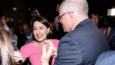 NSW Premier Gladys Berejiklian is congratulated by Scott Morrison as she enters the ballroom of the Sofitel Wentworth on election night.