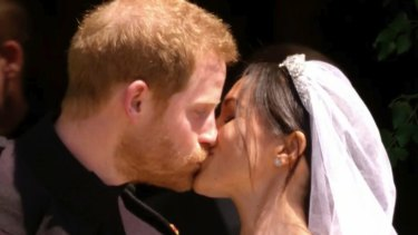 The Duke and Duchess of Sussex's first kiss as a married couple.