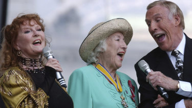 """Dame Vera Lynn, centre,  singer Petula Clark, left and entertainer Bruce Forsyth sing """"We'll Meet Again"""", during the World War II 60th Anniversary Service at Horse Guards Parade, in London, 2005."""