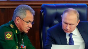 Russian President Vladimir Putin, right, and Defence Minister Sergei Shoigu in 2018.