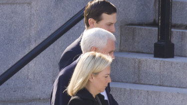 US Homeland Security Secretary Kirstjen Nielsen, foreground, Vice-President Mike Pence and White House senior adviser Jared Kushner on their way to a meeting with House and Senate leadership on Sunday.