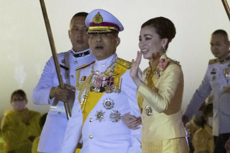 Thailand's King Maha Vajiralongkorn and Queen Suthida leave from Grand Palace after a ceremony marking the fourth anniversary of the death of his father.