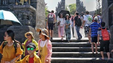 Chinese tourists dominate the scene at Tanah Lot.
