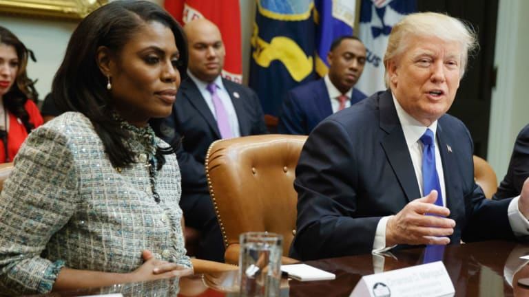 President Donald Trump speaks during a meeting on African American History Month with Omarosa Manigault Newman (left),