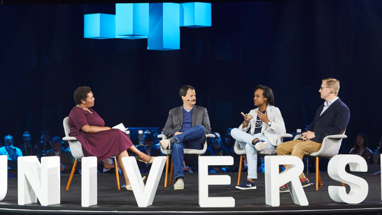 A roundtable at the GitHub Universe event. From left: Github director of social impact Admas Kanyagia; Miller Able from the Bill and Melinda Gates Foundation; Tiffani Ashley Bell of the Human Unity Project, and; Julius Sweetland of Optikey.