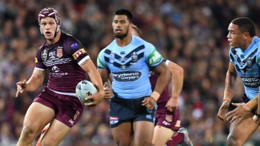 One step ahead: Kalyn Ponga makes a break for Queensland in Origin I.
