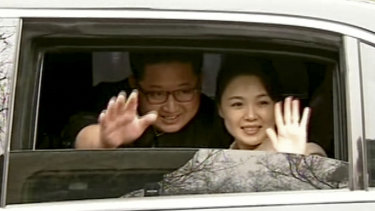 Kim Jong-un and his wife Ri Sol-ju wave from a car as they bid farewell to Chinese counterpart Xi Jinping and his wife Peng Liyuan in Beijing.