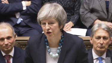 Theresa May announces that she has postponed Parliament's vote on her European Union divorce deal.