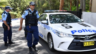 Police at the Church of Scientology headquarters in Chatswood on Thursday.
