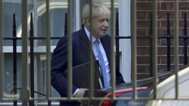 Boris Johnson leaves from the rear of 10 Downing Street on Thursday, on his way to the House of Commons.