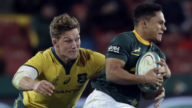 Strong chase: Australian captain Michael Hooper challenges Herschel Jantjies at Ellis Park in Johannesburg.
