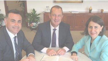 A screenshot of Michael Johnsen's webpage where he is photographed with John Barilaro and Gladys Berejiklian.