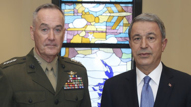 The US chairman of the Joint Chiefs of Staff, General Joseph Dunford, left, and Turkey's Defence Minister Hulusi Akar seen before a meeting, in Ankara, Turkey, on January 8.