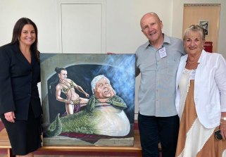 Senator Jacqui Lambie in her office with the Bald Archies portraitdepicting her as Princess Leia and Clive Palmer as Jabba the Hutt, which was dropped off by owners Ray and Elain.