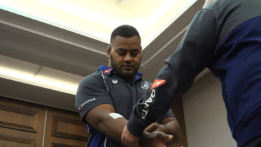 Taniela Tupou was robbed outside the Wallabies team hotel on the weekend and suffered minor cuts to his arm.