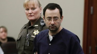Larry Nassar is escorted into court during his sentencing hearing in Lansing, Michigan in January.