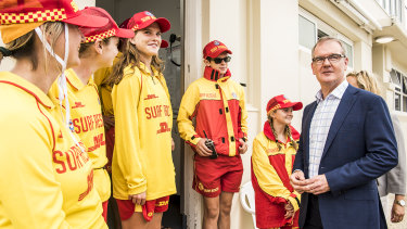 Labor leader Daley meets local surf life savers in Coogee while campaigning on Saturday.