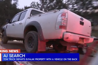A white Ford ute is seized during the search for missing child AJ Elfalak.