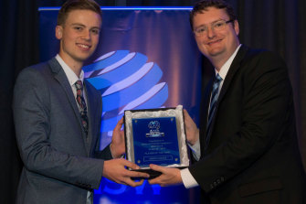Angus Chance receives his award as the NSW NPL3's under-20s player of the year in 2017 from Stuart Hodge, the chief executive of Football NSW.