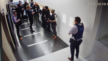 Victoria Police and the Australian Border Force raid the offices of Frank Hu.