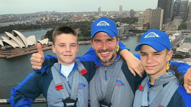David Beckham with sons Cruz and Romeo climbing the Sydney Harbour Bridge on Wednesday.