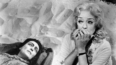 Bette Davis plays an ageing child star opposite her great screen rival, Joan Crawford, as her paraplegic sister, in the 1962 psychological horror thriller Whatever Happened to Baby Jane?