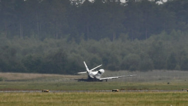 The private aircraft near the runway after it caught fire on landing at Aarhus Airport in Tirstrup, Denmark.