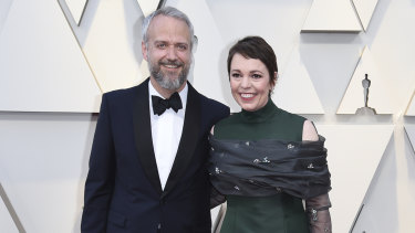 Olivia Colman and her husband Ed Sinclair arrive at the Oscars.