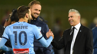 Sydney FC coach Steve Corica (right)  congratulates Milos Ninkovic after their incredible win on Sunday night.
