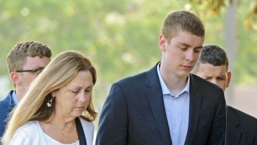 Brock Turner, right, makes his way into the Santa Clara Superior Courthouse in Palo Alto, California in 2016.