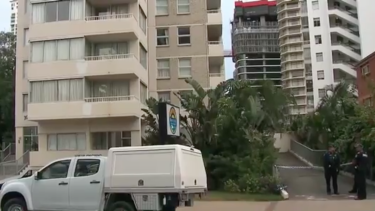 Police at the Gold Coast high-rise on Saturday after the teenager's fatal fall.