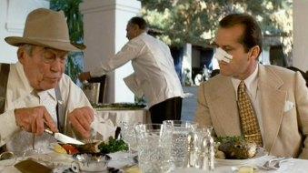 "John Huston (left) as Noah Cross and Jack Nicholson as J. J. ""Jake"" Gittes in Chinatown."